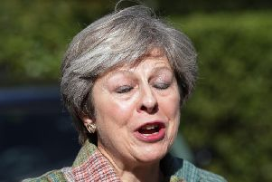 Theresa May says she will stand up and fight back against the plotters seeking to replace her as Prime Minister.