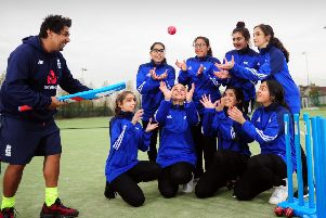 Catch of the day: Members of Carlton Bolling College's girls cricket team with coach Zaheer Jaffary. (JPress).
