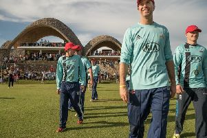 Bowled over: Michael Vaughan walks out to field in Kigali with England international Sam Billings for the launch of the new cricket stadium. Picture: Paul Broadie.