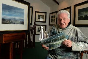 Ashley Jackson in his Holmfirth gallery with his new book. (Picture: Bruce Rollinson).