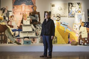 Lubaina Himid with one of her works of art titled A Fashionable Marriage, at the Ferens Art Gallery in Hull. (PA).