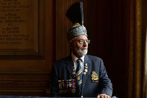 Mohammed Saddique, 88, wears medals won by his father Ghulam Hassan during naval service in both world wars. Picture: Bruce Rollinson