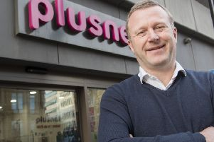 Chief executive Andy Baker celebrates outside Plusnet headquarters at The Balance in Sheffield. Pic Dean Atkins.