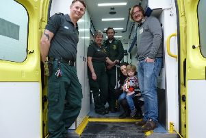 Ambulance crew Andy Towers, Wendy Durkin and Andrew Hughes with Leeds couple Katy and Ian Bavill and their son Ralph.