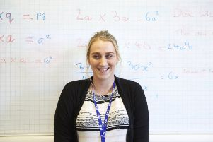 A happy supply teacher working for Vision for Education, part of TES Global which is expanding in Sheffield.