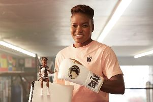 "Leeds's double Olympic boxing champion Nicola Adams with a one-off first ever ""boxer Barbie"", which was  unveiled for International Women's Day. PHOTO: Mattel/PA Wire"