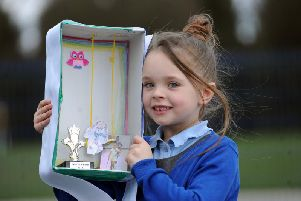 Faye Clayton from Thorpe Primary School takes part in the 'I Am' arts project by creating her shoebox. Picture Scott Merrylees.