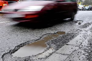 The millions of potholes which scar our towns, cities and countryside are a growing problem that need an urgent solution. (PA).