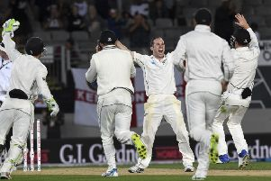 New Zealand bowler Todd Astle raises his arms and celebrates with his team-mates after the dismissal of England's James Anderson saw the hosts win the first Test by an innings and 49 runs in Auckland (Picture: Ross Setford/AP).