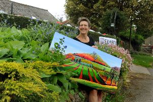 Artist Sue Slack with her landscape of Roseberry Topping exhibiting at Lockton, north of Pickering
