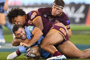 INTENSE: New South Wales' James Tedesco is tackled by Queensland's Felipe Kaufusi during game one of the State Of Origin series at the MCG, Melbourne last week. Picture: Quinn Rooney/Getty Images)