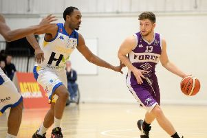 Isaac Mourier battles past Malcolm Riley for Leeds Force against Cheshire Phoenix in the BBL Championship last season.  Picture: Bruce Rollinson