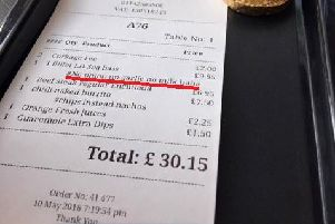 The bill, with the offending message underlined in red