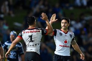 STAR TURN: New Zealand Warriors' Shaun Johnson celebrates with Roger Tuivasa-Sheck after kicking a goal  against North Queensland Cowboys. Picture: Ian Hitchcock/Getty Images.