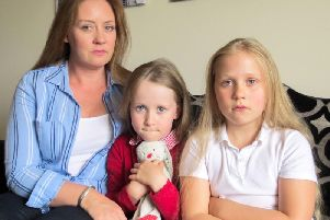 Janet Alexander with her daughters Rose and Lois, who is suing holiday company Thomas Cook after claiming her daughter was abducted from a hotel kids club in Turkey. Image: Digby Brown