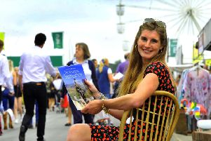 120718   The Yorkshire Shepherdess Amanda Owen with her new 2019 calendar  at the Great Yorkshire Show .