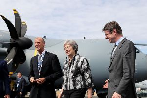 British Prime Minister Theresa May talks with Airbus CEO Tom Enders (left) as she officially opened the Farnborough International Airshow in Hampshire. PA