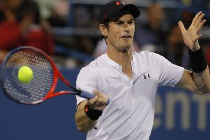 On his way to victory: Andy Murray returns against Mackenzie McDonald.