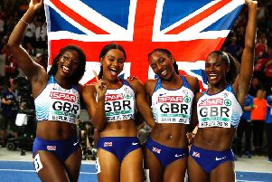Great Britain's Asha Philip (left), Imani Lansiquot, Bianca Williams (second right), and Dina Asher-Smith (right) celebrate winning the gold medal in the women's 4x100m relay final. PIC: Martin Rickett/PA Wire