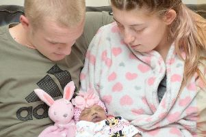 Demi Wragg and her partner Jack Thomas with their daughter Myla-Jai Sharon Thomas, who died aged just three days