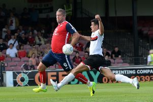 KEEP ON SMILING: Jon Parkin, in action for York City against FC United of Manchester last season. Picture: Bruce Rollinson