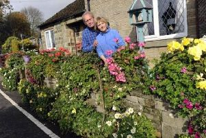 Sally and Brian Williams outside their cottage on Hollin House Lane, Loxley Valley.