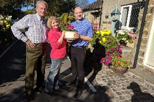 Councillor Jack Scott offered the Loxley couple a potted plant as a peace offering