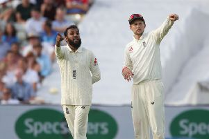 England's bowler Adil Rashid (left) talks with England captain Joe Root in the Test match at Edgbaston against India earlier this summer. Picture: Nick Potts/PA