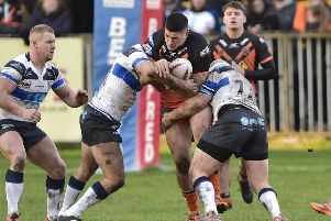 Mitch Clark in action for Castleford Tigers against Featherstone Rovers in last year's festive fixture. Picture: Matthew Merrick