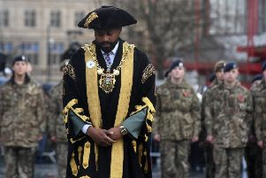 Lord Mayor of Sheffield Coun Magid Magid, wearing a white poppy, at the remembrance parade at Barkers Pool.