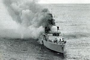 Smoke pours from the HMS Sheffield after the deadly missile strike during the Falklands War