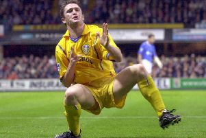 Robbie Keane celebrates scoring for Leeds United against Ipswich Town.