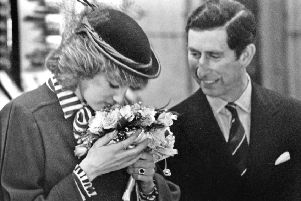 Prince Charles and Princess Diana admire a bouquet by florist Annie Valentine, March 15, 1984.