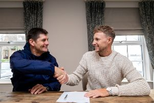 STICKING AROUND: Yorkshire County Cricket Club's Joe Root is pictured with Director of Cricket Martyn Moxon as he signs a new contract with the club. Picture: Alex Whitehead/SWpix.com
