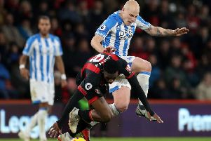Huddersfield Town's Aaron Mooy in action against Bournemouth. The Australian has been ruled out until February (Picture: PA)