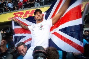 On top of the world: Mercedes' Lewis Hamilton.