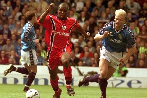 On the attack: York's Rodney Rowe goes past the Manchester City defence.