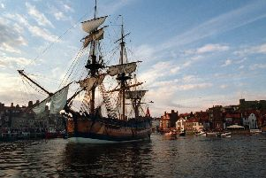 A replica of HMS Bark Endeavour sails into Whitby Harbour.