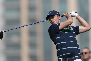Matthew Fitzpatrick of England tees off on the 5th hole during round one of the Dubai Desert Classic golf tournament, in Dubai, United Arab Emirates. (AP Photo/Neville Hopwood)
