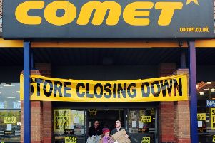 People leave a Comet store in York on its final day of trading.