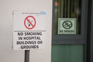 Batley and Spen MP Tracy Brabin wants the law changed to ban smoking on all hospital grounds.