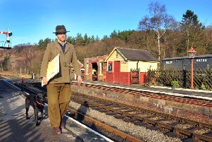 Chris Ware watercolour artist at Levisham station on the North York Moors railway with his dog Rumba.