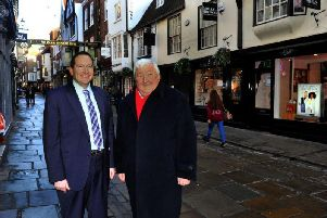 Councillor Keith Aspden (left) and Coun Ian Gillies, leader of York City Council, pictured in Stonegate in York city centre. Footfall in the city centre grew last year to buck the national trend. Picture by Gary Longbottom.