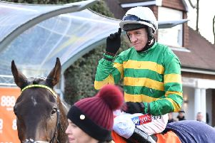 Buveur D'Air, Barry Geraghty and stable lass Hannah Ryan after the horse's win at Sandown.