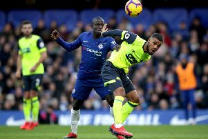 Central character: Huddersfield Town's Elias Kachunga battles with Chelsea's N'Golo Kante.