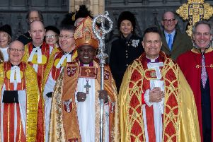 Archbishop of York, John Sentamu, next to The Dean of York The Right Reverend Dr Jonathan Frost, on the steps of York Minster after the service.
