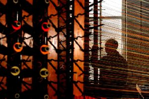 Bernard Wadsworth with a moquette loom at Calderdale Industrial Museum in Halifax. PIC: Tony Johnson