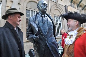 Sculptor Martin Jennings, left, shares a joke with the Lord Mayor of Hull, Coun David Gemmell, after he had unveiled the statue of poet Philip Larkin in Hull Paragon Interchange.