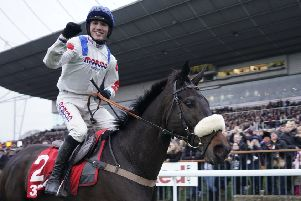 Harry Cobden celebrates his King George VI Chase win on Clan Des Obeaux who is due to line up at Newbury this weekend.