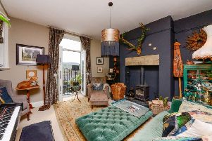 The sitting room is painted in Farrow and Ball colours and has an oriental theme.
